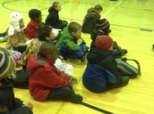 First graders being reverent at Morning Gathering.
