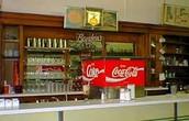 A Coke serving soda fountain.