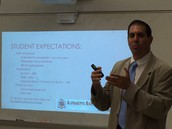 Dr. Wynne explains student expectations on Curriculum Night
