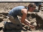 Archeologist looking at a pot