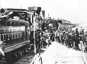 People aboarding the Transcontinental Railroad