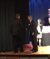 Mr. Hannan receiving award from Dr. Lowder