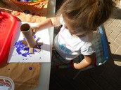 Brooklynn using recyclable objects to paint