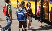 Be cautious when students are entering or exiting a school bus.