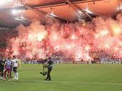 Flares set off in soccer stadium, causing damage!