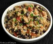 Poyo y arroz con los legumbres