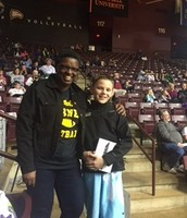 John Wimmer, winner of the halftime competition and Ms. Myles at the Eagles' game.