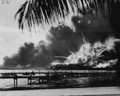 The explosion of the USS Shaw after a Japanese air raid.