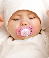 Sucking on a pacifier