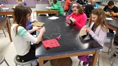 5th graders stitching in art