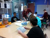 Mrs. Adams talking about drawing.