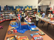 Second graders checking out the nonfiction books and more at the book fair!