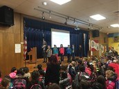 Ms. Pearlman's 2nd grade Panthers lead us in the pledges at morning assembly!