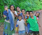 The Micronesia skin color is light brown and hair is black and gray.