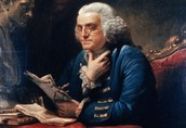 Benjamin Franklin writing the Constitution