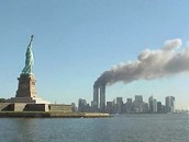 This is a view of the Statue of Liberty with the Twin Towers in the background