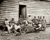 Slaves gathered outside their home