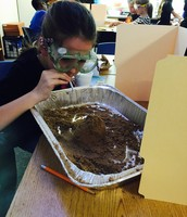 Demonstrating weathering by wind in Mrs. Talley's class!