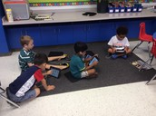 Here are some of our boys using KIDS A-Z!