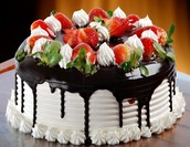 Delicious chocolate cake with fresh strawberries.