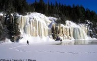 A awesome picture of a frozen waterfall