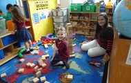 Ms. Gaby and Clara building their tower
