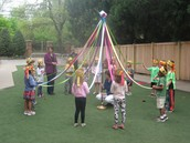 Doing our Maypole dance.