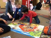 Chase and Mustafa putting a puzzle together