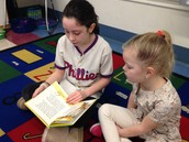 Ana reading to a kindergartener