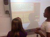 Discussing a text (students paired in Kristie McCray's room to read a passage and analyze)