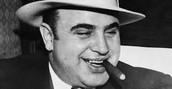 Capone smoking his favorite cigar