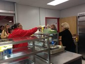 Dr. Mattox, Doris, Melissa and several others served hot dog plates!