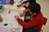 Abdel Hamid working on his Aboriginal Art Project