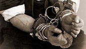 Harry Houdini in handcuffs.