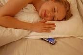 Women sleeping with phone.