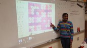 One of Mr Rogers' great mathemagicians explains her order of operations tile design in class.