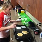 Mrs. Price cooking away!