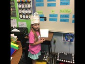Ava explaining her Math Problem (IPS) to the class using the document camera.