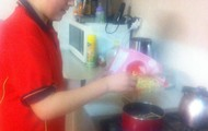 Pouring the noodles in the pan