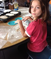 Marissa rolling her chapati out