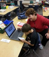Showing mom around a lap-top, 1st grade style!