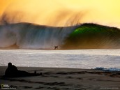 Here is a surfer riding on the waves of Oahu.