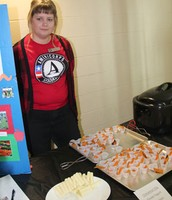 Nikki Halverson Americorps member hands out healthy snacks.