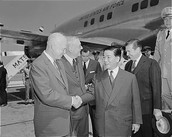 1957- U.S. President Dwight D. Eisenhower and Secretary of State John Foster Dulles greet president Ngô Đình Diệm of South Vietnam