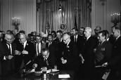 President Johnson signs the Civil Rights Act of 1964