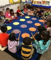 Playing our rhythm sticks!