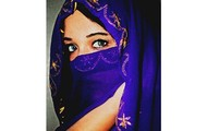 A woman wearing a tourban