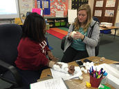 A. White and T. Sumpter create a cast that they designed.
