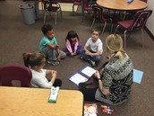 Ms. Alison works with a small group at JP