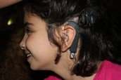 a kid with hearing impairment
